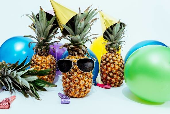 Lifefull photo of three pineapples surrounded by balloons 1071882