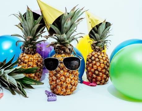 Splashside photo of three pineapples surrounded by balloons 1071882